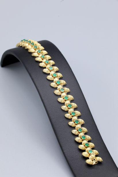 Bracelet en or jaune 18K à décor grain d'orge...