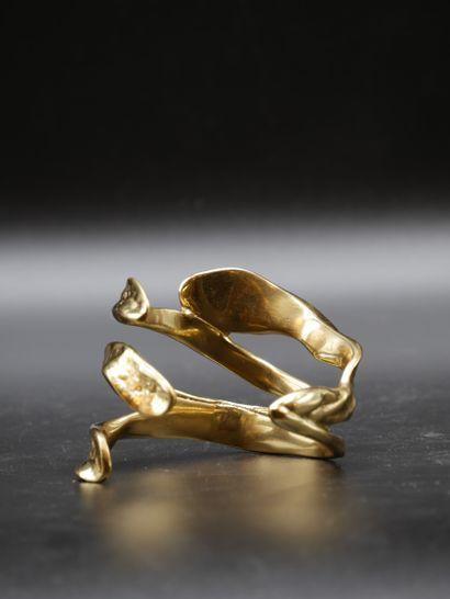 Bracelet en métal doré en forme de feuillage...