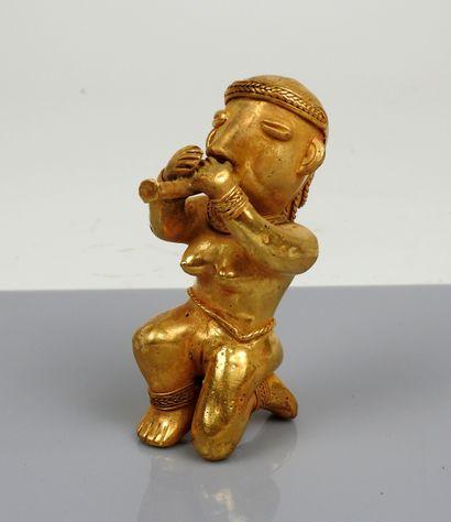 Statuette représentant une joueuse de flûte...