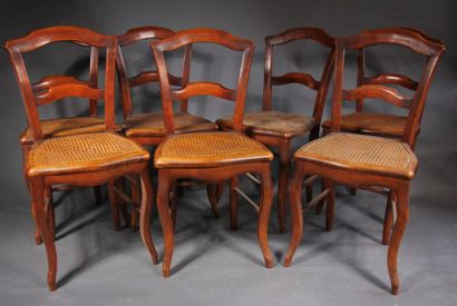 *Lot de sept chaises cannées à bandeau, Louis...
