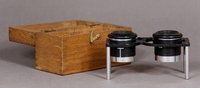 Binoculaire en métal dans un boitier en bois...