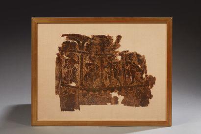 Fragment de textile représentant des personnages...