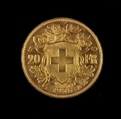 *Une pièce de 20 F Suisse en or