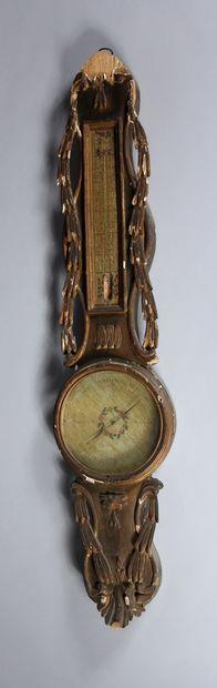 Baromètre-thermomètre en bois sculpté redoré...