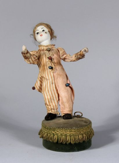 Automate représentant un enfant à tête, main...