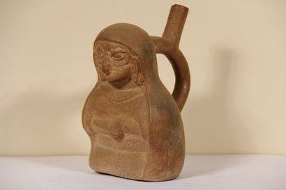 Vase étrier représentant un personnage portant...