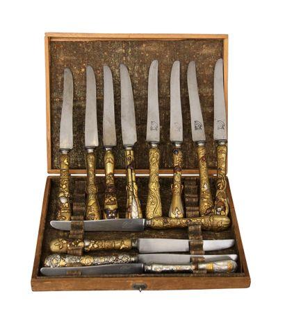 *Douze couteaux à lames en acier signées,...