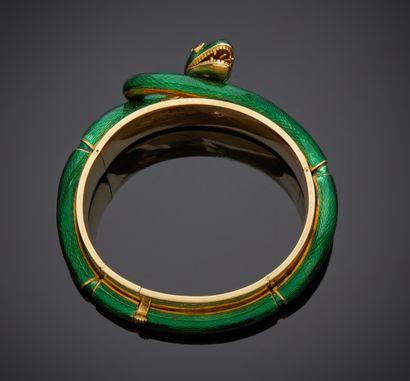 *Bracelet rigide et articulé ouvrant en or jaune 750 millièmes encerclé d'un motif...