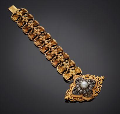 *Bracelet articulé en or jaune 750 millièmes et argent 925 millièmes, les maillons...