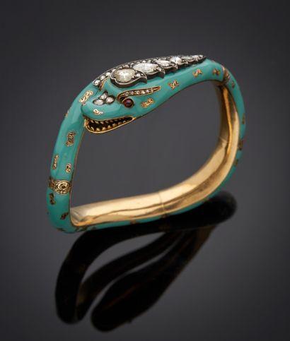 *Bracelet rigide ouvrant en or jaune 750 millièmes figurant un serpent enroulé partiellement...