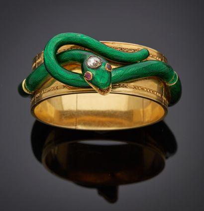 *Bracelet rigide et articulé ouvrant en or...