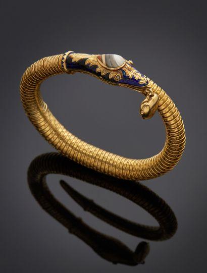 *Bracelet tobogaz en or jaune 750 millièmes figurant un serpent enroulé, la queue...