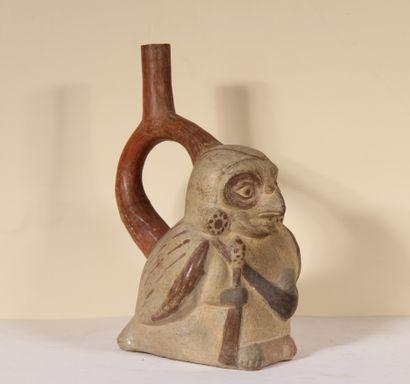 Vase étrier représentant un homme à tête...