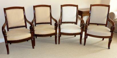 Quatre fauteuils en acajou et placage d'acajou,...