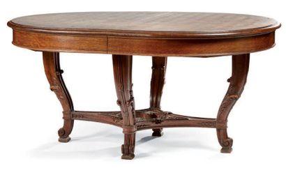 Table de salle à manger de forme ovale en...