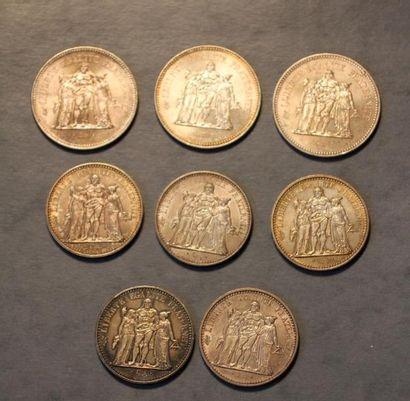 Trois pièces de 50 FF et cinq pièces de 10...