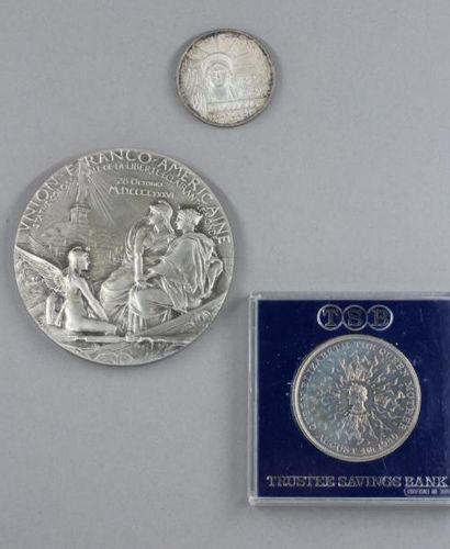 - Une pièce de 100 FF 1986  - Une médaille...