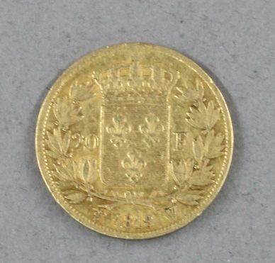 *Une pièce de 20 FF 1818 en or