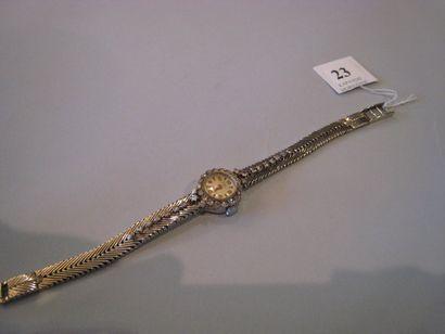 Montre de dame en or gris cadran rond, bracelet...