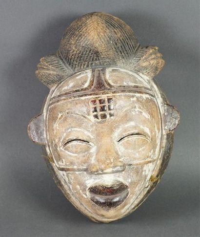 Masque style Punu en bois sculpté polychrome....
