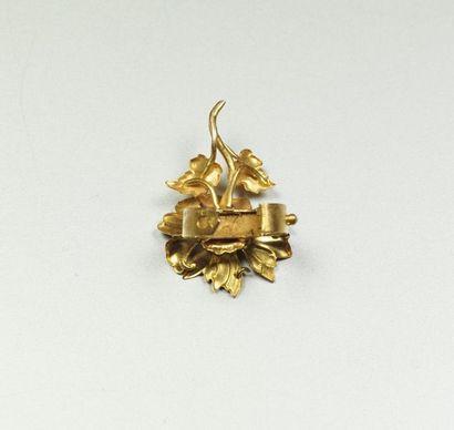 Coulant de sautoir en or jaune 18K (750/oo) figurant une fleur. Poids brut : 1,8...