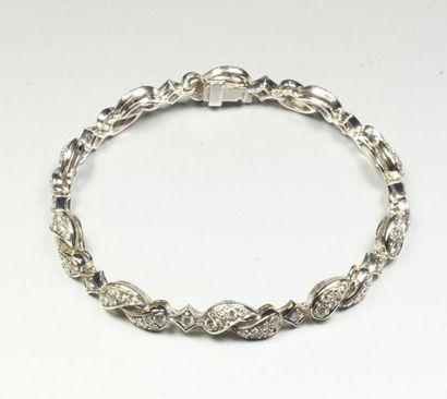 Bracelet semi rigide en or gris 18K (750/oo)...