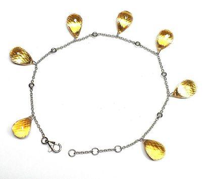 Bracelet or blanc orné par 7 citrines briolétées...