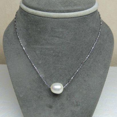 Un pendentif Perle de culture naturelle diamètre...