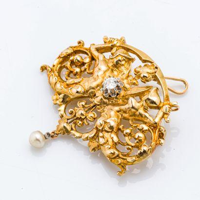 Broche-pendentif en or jaune 18 carats (750 millièmes) à décor sysmètrique de tritons...