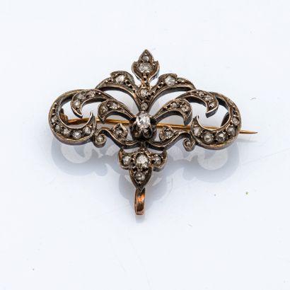 Broche-pendentif fleuron en or jaune 18 carats...