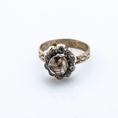 Bague fleur en or gris 18 carats (750 millièmes)...