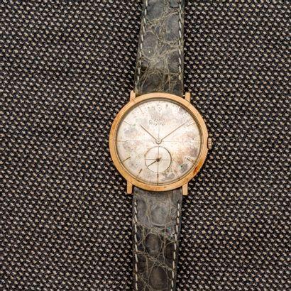 CORUM, vers 1960  Montre bracelet en or jaune...