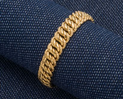 Bracelet gourmette en or jaune 18 carats...