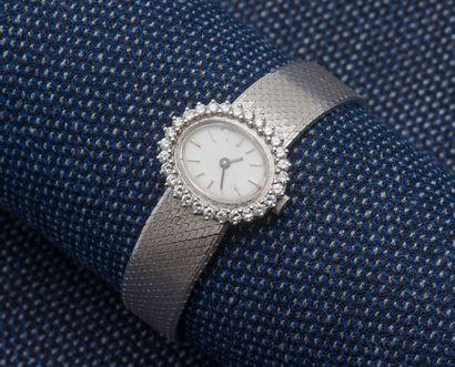 Bracelet montre de dame en or gris 18 carats...