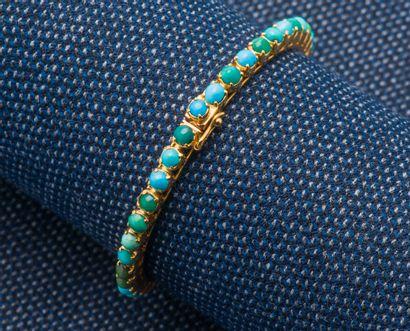Bracelet jonc ouvrant en or jaune 18 carats...