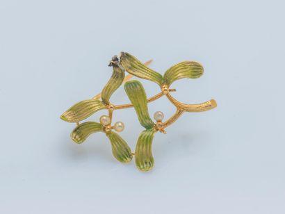 Broche en or jaune 18 carats (750 ‰) figurant...