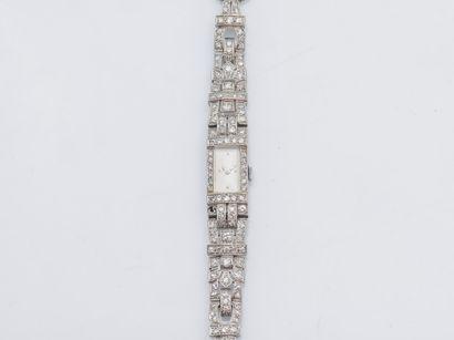Bracelet montre en platine (950 ‰) et métal,...