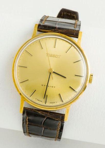 TISSOT  Montre classique «Stylist». Boîtier rond en or jaune 18 carats (750 millièmes),...