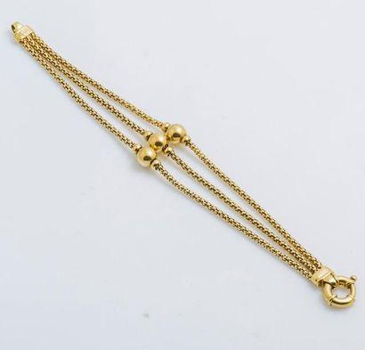 Bracelet trois rangs en or jaune 18 carats...