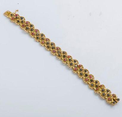 Bracelet ruban articulé en or jaune 14 carats...