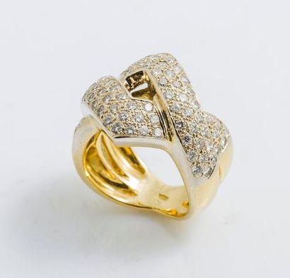 Bague croisée en or jaune et or gris 18 carats...