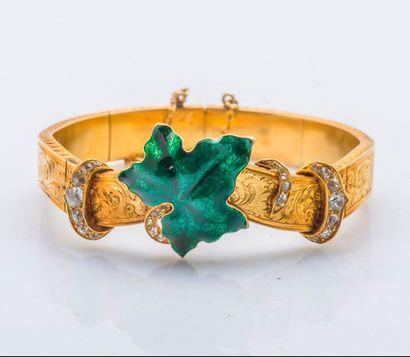 Bracelet rigide ouvrant en or jaune 14 carats...