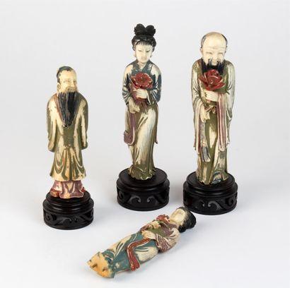 Quatre SUJETS en ivoire sculpté polychrome...