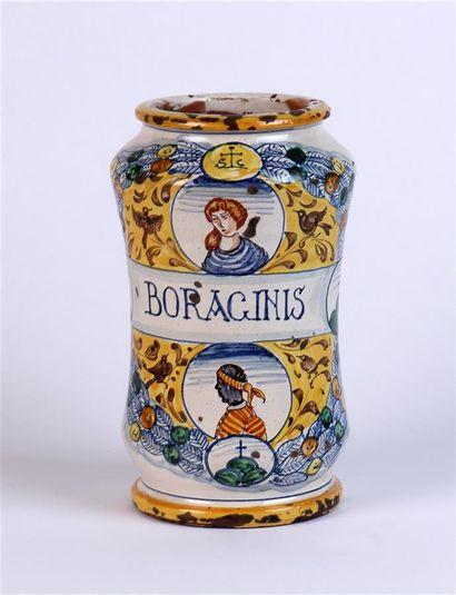 ALBARELLO en faïence à décor de personnages polychromes dans des médaillons. Italie,...