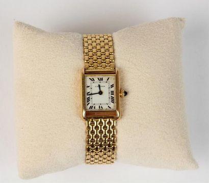 CARTIER, modèle TANK MONTRE bracelet de dame en or 18k (750 °/°), boîtier rectangulaire...