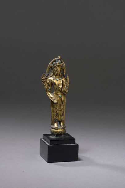 TIBET - 16th century Statuette of Padmapani standing in gilt bronze inlaid with...
