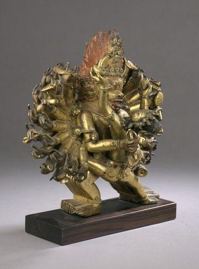 TIBET - 18th century Group in gilt bronze of Vajrabhairava, standing in alidhasana,...