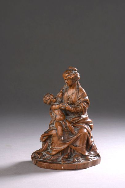 VIERGE à l'Enfant assise en buis sculpté...