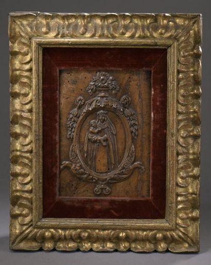 PANNEAU en bois sculpté en bas-relief représentant...