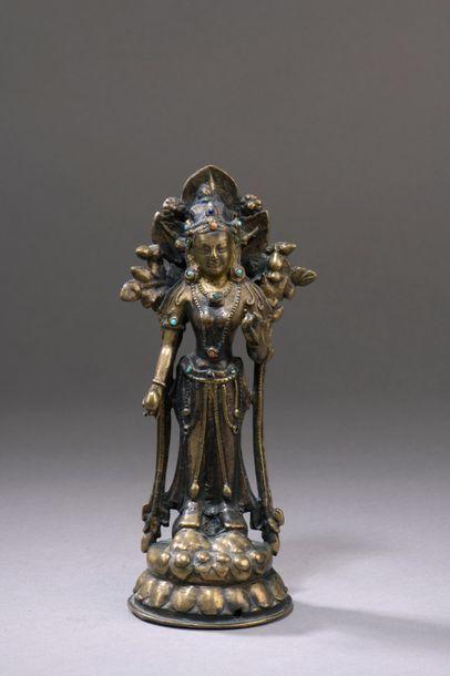 TIBET - XIIIe/XIVe siècle Statuette en laiton...
